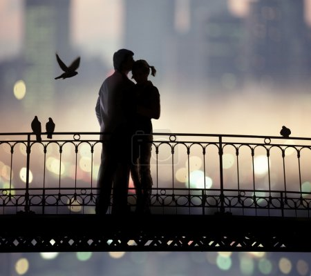 Photo for Silhouette of bridge and pair of lovers on city background - Royalty Free Image