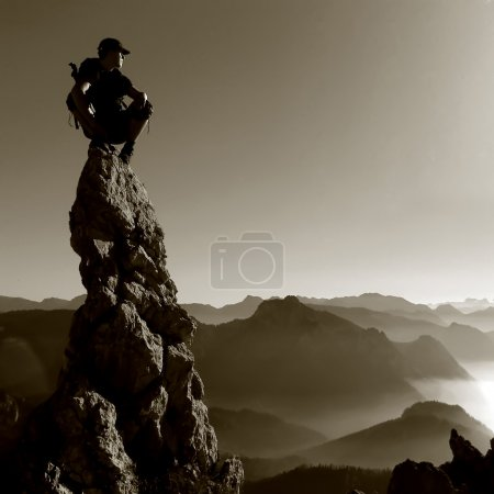 Mountain scenery - man on a rock top