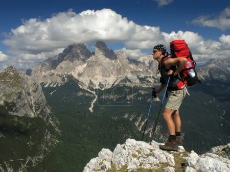 Tourist with backpack in the mountains