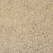 Detail of the surface of rounded sand...
