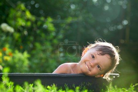 Baby lying on the bathtub