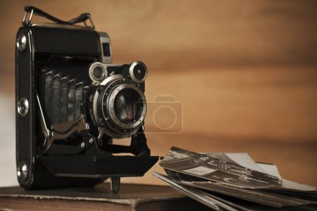 Photo for Old camera with photos - Royalty Free Image