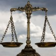 A photo of the scales of justice with a balance th...