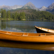 Mountain lake with boats in National Park High Tat...