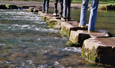 Crossing river on stepping stones