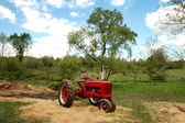 Old Red Tractor on Farm