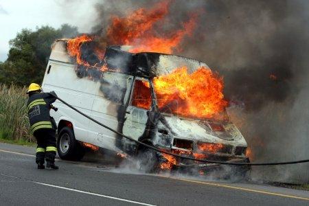 Fireman and Burning Motor Car
