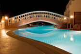 Pool of Greek hotel at night