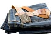 Blue denim jeans and strap leather belt