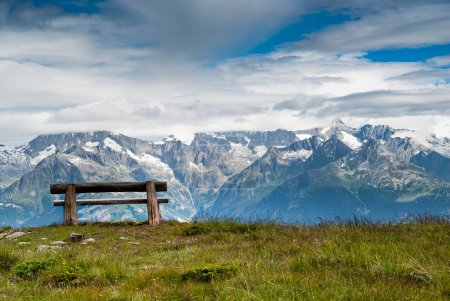 Empty park bench in high mountains