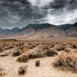 Panoramic view of dark clouds in death valley nati...