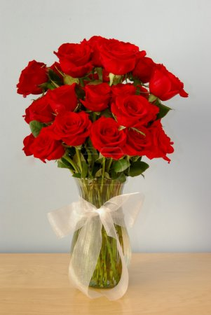 Photo for Three Dozen Red Roses in a Vase - Royalty Free Image