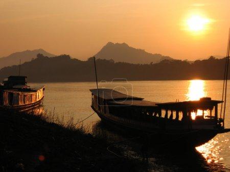 Big boats on Mekhong bank at sunset