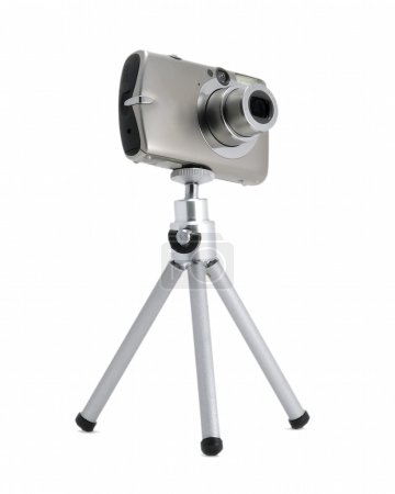 Photo for Photo camera on tripod isolated over white - Royalty Free Image