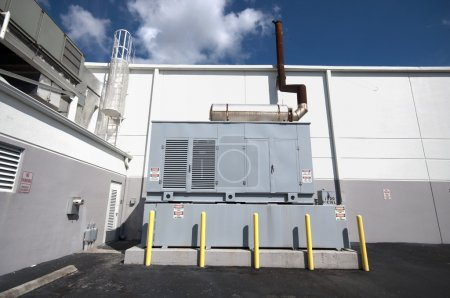 Diesel backup generator on the outside of an indus...