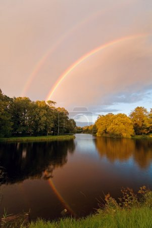 Rainbow over autumn pond