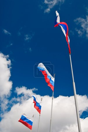 Four waving Russian flags