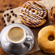 Fresh doughnut and cookies with an espresso...