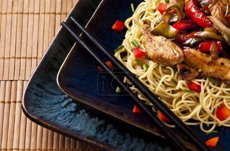 Photo for Chicken stir fry with red peppers onion and green beans - Royalty Free Image