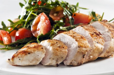 Photo for Grilled chicken breast served with salad - Royalty Free Image