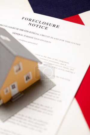 Foreclosure Notice and House on Flag