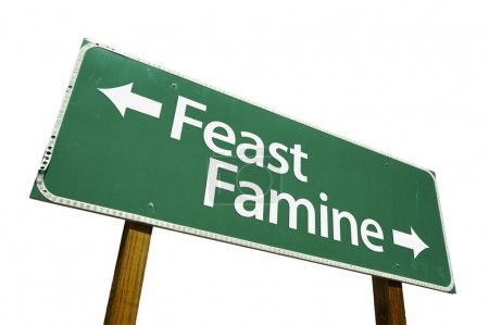Feast Famine Green Road Sign on White
