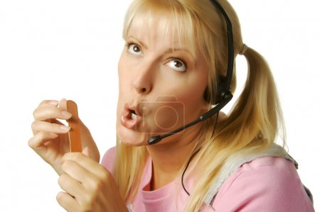 An obviously bored customer support girl waiting f...