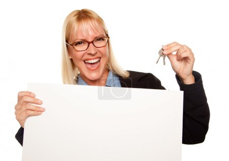 Pretty Woman Holding Keys and Blank Sign