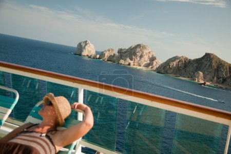 Relaxed Woman Lounges on a Cruise Ship Deck