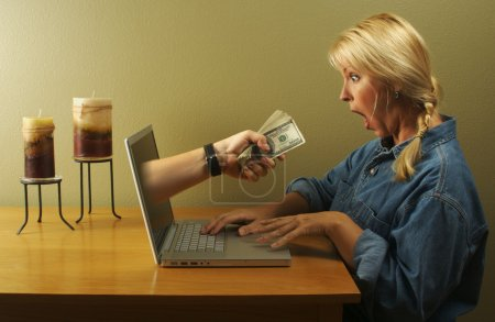 Money Through Laptop Screen and Woman