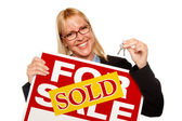 Woman Holding Keys Sold For Sale Sign