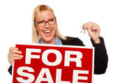 Woman Holding Keys and For Sale Sign