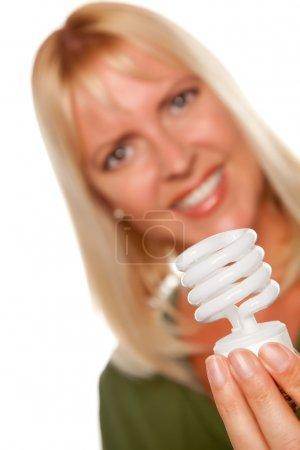 Blonde Holds Energy Saving Lightbulb