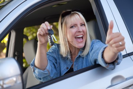 Happy Woman In New Car with Keys