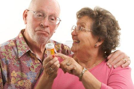 Senior Couple With A Prescription Bottle