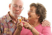 Senior Couple With A Prescription Bottle