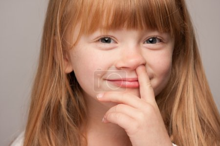 Red Haired Girl with Finger in Her Nose