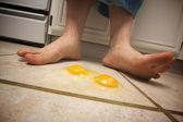 Eggs on the Floor at Mans Feet