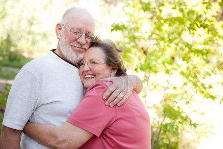Loving Senior Couple Enjoying Outdoors Together