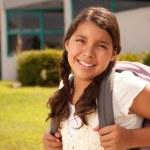 Cute Hispanic Teen Girl Student with Backpack Read...