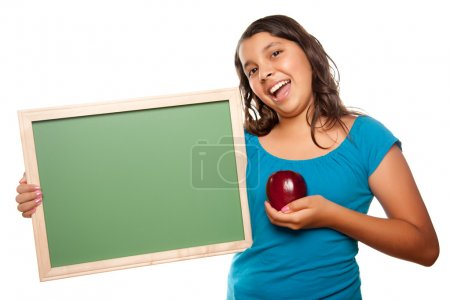 Photo for Pretty Hispanic Girl Holding Blank Chalkboard and Apple Isolated on a White Background. - Royalty Free Image