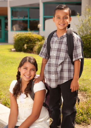 Hispanic Brother and Sister at School