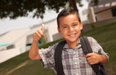 Happy Young Hispanic Boy with Backpack