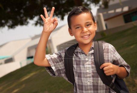 Happy Young Hispanic Boy with Backpack