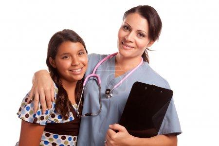Young Hispanic Girl and Female Doctor