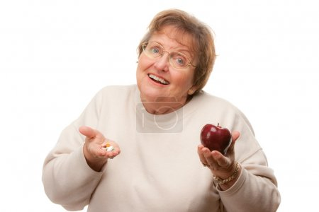 Confused Lady Holding Apple and Pills