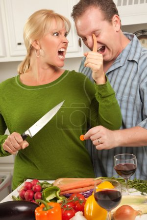 Man Gets too Close To Wife Cutting Food