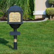 Classic Mailbox Surrounded by Lush Green Grass....