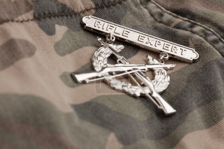 Rifle Expert War Medal on Camouflage