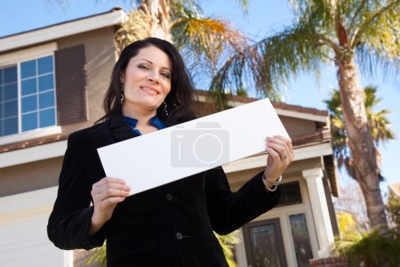 House and Woman Holding Blank Sign